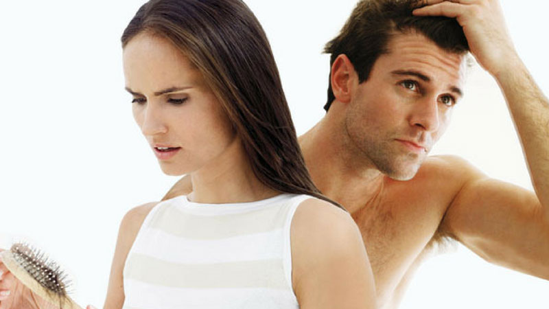 A Woman and A Man Worrying About Hair Loss